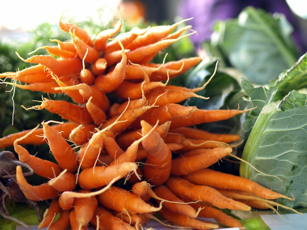 carrots at the market - budget friendly grocery shopping tips by robin shirley